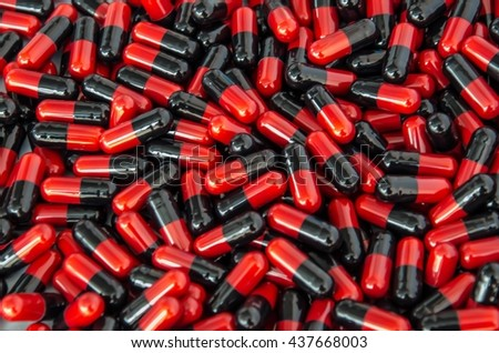 soft focus antibacterial  medicine /red&back capsules/pills/medicines background  - stock photo