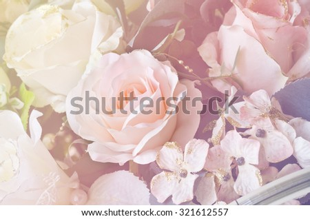 Soft focus artificial orange and white rose  flowers bouquet - stock photo