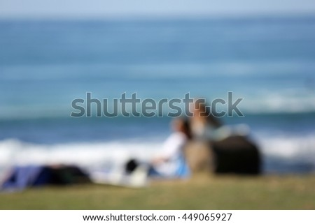Soft Focus Couple looking at the Ocean - stock photo