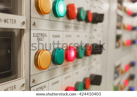 Soft focus electrical fault lighting on control panel board. - stock photo