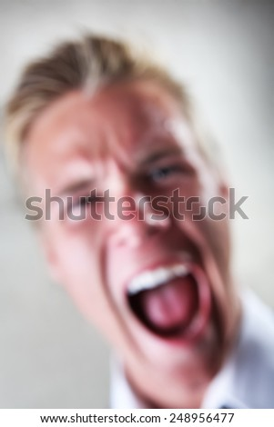 Soft focus image of a yelling man. - stock photo