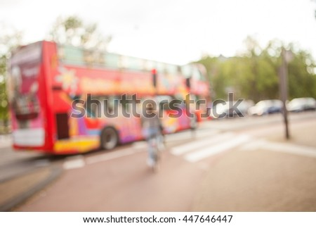 Soft focus image of young women crossing the crossroad of modern city. Ecological means of traveling. - stock photo