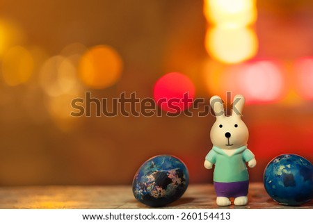 soft focus of easter decorate with rabbit toy and easter eggs on night light bokeh background. vintage color tone.  - stock photo