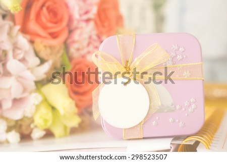 soft focus of gift box with blank card for your text,vintage color tone. - stock photo