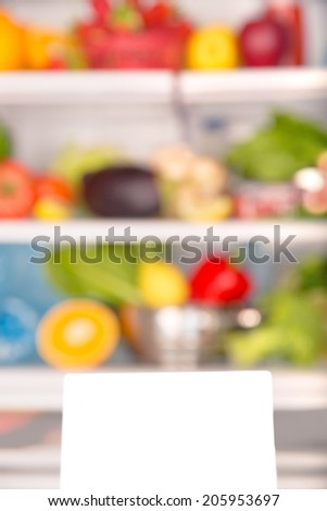 Soft focus of open fridge full of fresh fruits and vegetables, healthy food background, organic nutrition, health care, dieting concept - stock photo