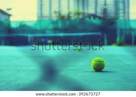 soft focus of tennis ball on tennis cement court - stock photo