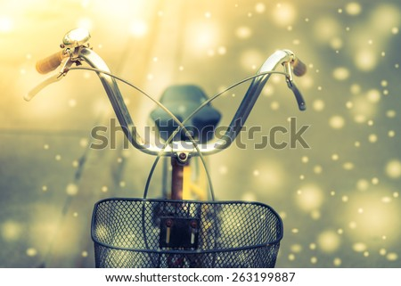 Soft focus on Vintage bicycle Winter scence - vintage and snow effect - stock photo