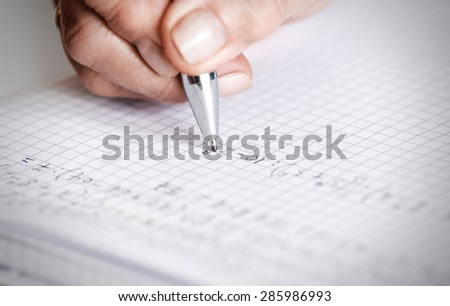 soft focus pen writing by female hand. - stock photo