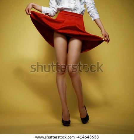 soft focus picture with grain. female legs in high heels shoes with lifted skirt - stock photo
