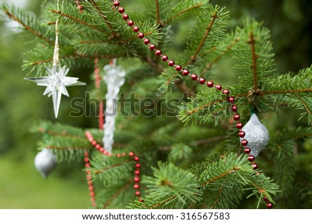 Soft Focus Sparsely Decorated Christmas Tree - stock photo