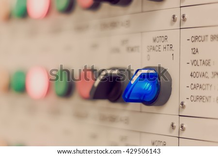 Soft focus the electrical safety background the motor lighting on control panel board in electrical safety room. - stock photo
