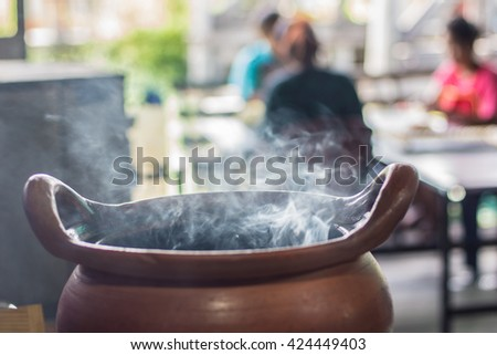 Soft focus The smoke from the cooking pot. - stock photo