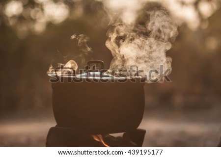 soft focus the steam from the rice cooker vintage tone - stock photo