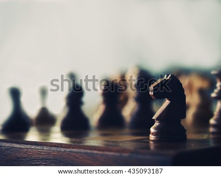 Soft focus wood knight chess on the chess board game and vintage color, The idea of winning and strategies. - stock photo