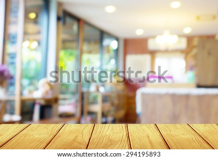 soft focus wooden table with blur coffee shop Background - stock photo