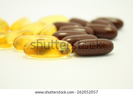 soft gel capsules supplement medicine pills on white background - stock photo