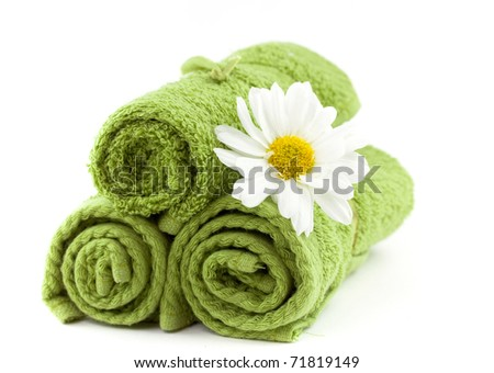 Soft green cotton towels with daisy - stock photo