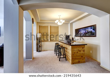 Soft ivory bar room with built in the wall aquarium - stock photo
