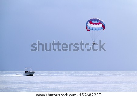 Soft morning lighting illuminates the large para sail in this monochromatic environment of cool, blue colors in Key West, Florida. - stock photo