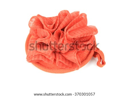 Soft orange bath puff or sponge isolated on white background - stock photo