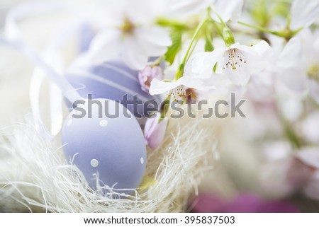 Soft pastel Easter eggs and cherry blossoms, high key image. - stock photo