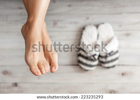 Soft photo of woman's feet with slippers, top view point - stock photo