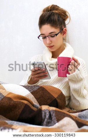 Soft portrait of cute  teenage girl with palmtop at home - stock photo