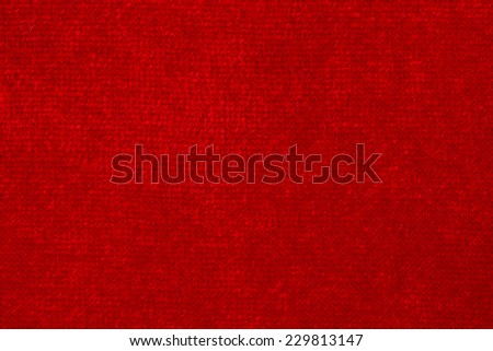 Soft red fabric woven as a background texture - stock photo
