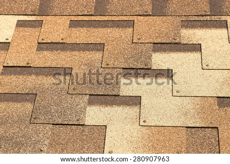 Soft roof. Shingles different shades of brown. High-tech roofing product from SBS-modified bitumen. - stock photo