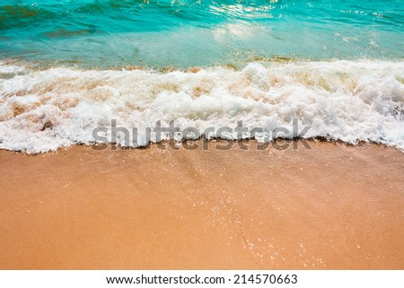 Soft Sea Ocean Waves Wash Over Golden Sand Background - stock photo