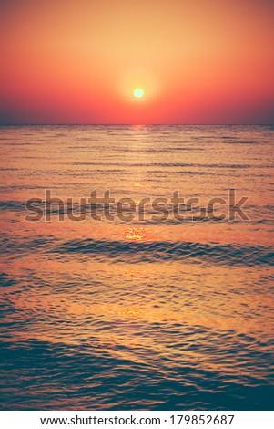Soft sea ocean waves wash over golden sand background. Sunset, sunrise, sun - stock photo
