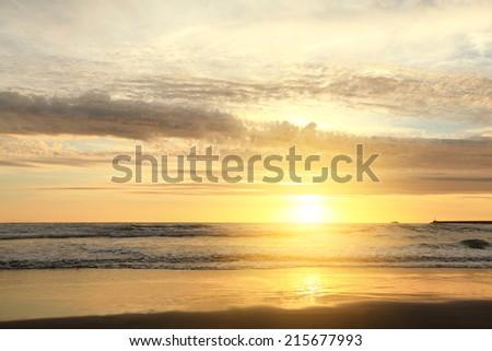 Soft Sea Ocean Waves Wash Over Golden Sand Background. Sunset, Sunrise, Sun. - stock photo
