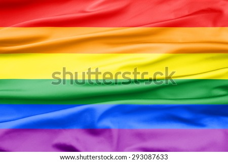 Soft Velvet Piece of Fabric with Folds in rainbow color to be used as background or overlay - stock photo