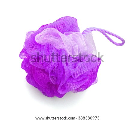 Soft violet bath puff or sponge isolated on white background with copy space.  - stock photo