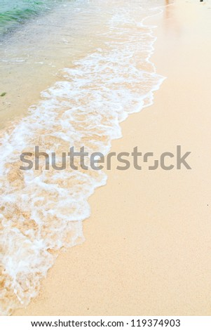 Soft wave of the sea on the sandy beach. - stock photo