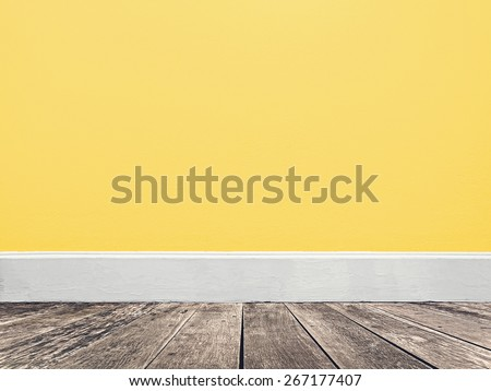 soft yellow wall and wooden floor - stock photo