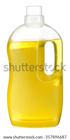 Softener bottle / studio photography is transparent plastic bottle with yellow liquid laundry detergent, cleaning agent, bleach or fabric softener - isolated on white background - stock photo