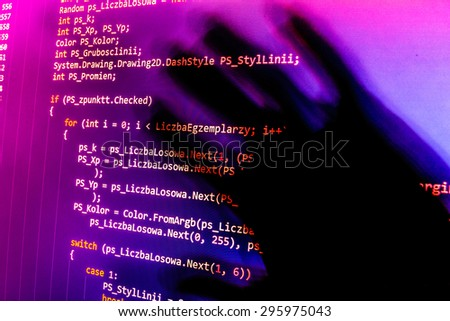 Software developer programming code on computer. Abstract computer script source code. Shallow depth of field, selective focus effect. Code text written and created entirely by myself. - stock photo