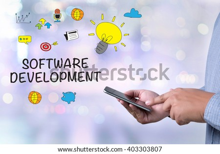 SOFTWARE DEVELOPMENT person holding a smartphone on blurred cityscape background - stock photo