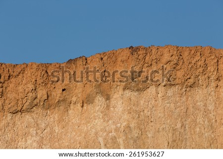 Soil cross section and blue sky - stock photo