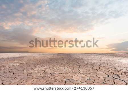 Soil drought cracked landscape sunset - stock photo