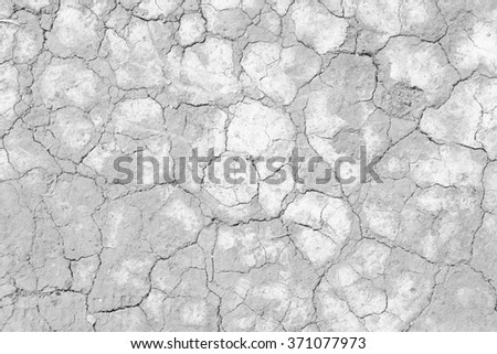 Soil drought cracks texture white and black. - stock photo