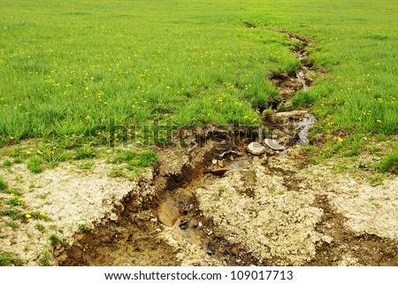 Soil erosion, damage of field by water. - stock photo
