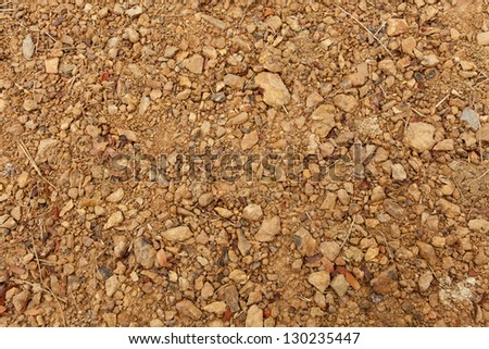 soil texture, brown ground soil texture mixed with small rocks - stock photo