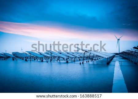 solar and wind power in bad weather,green energy background. - stock photo