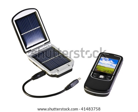solar battery and charged from her mobile phone - stock photo