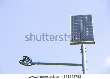 solar battery powers an electric lamp in the park - stock photo