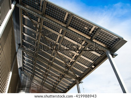 Solar battery view from below against clear blue sky on a spring day - stock photo