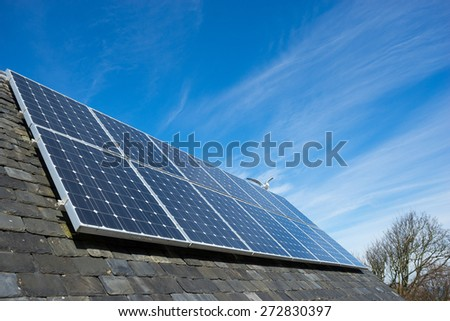 solar cell panel on house's roof, green energy - stock photo