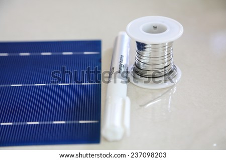 Solar cell panel with bus wire and flux pen - stock photo